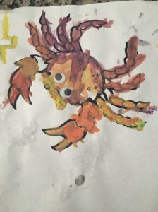 This was Monster M, age 4, and her crab.  At first she wanted to just make a huge mess with the paint but once she realized her brother and sister were creating masterpieces, she too wanted to join in.